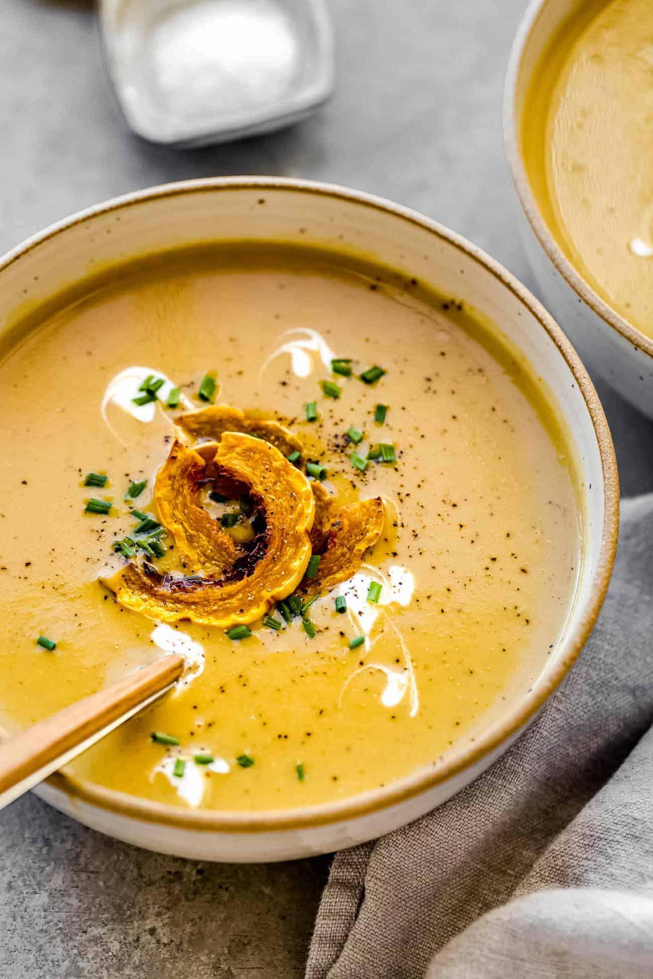creamy delicata soup with roasted delicata squash on top