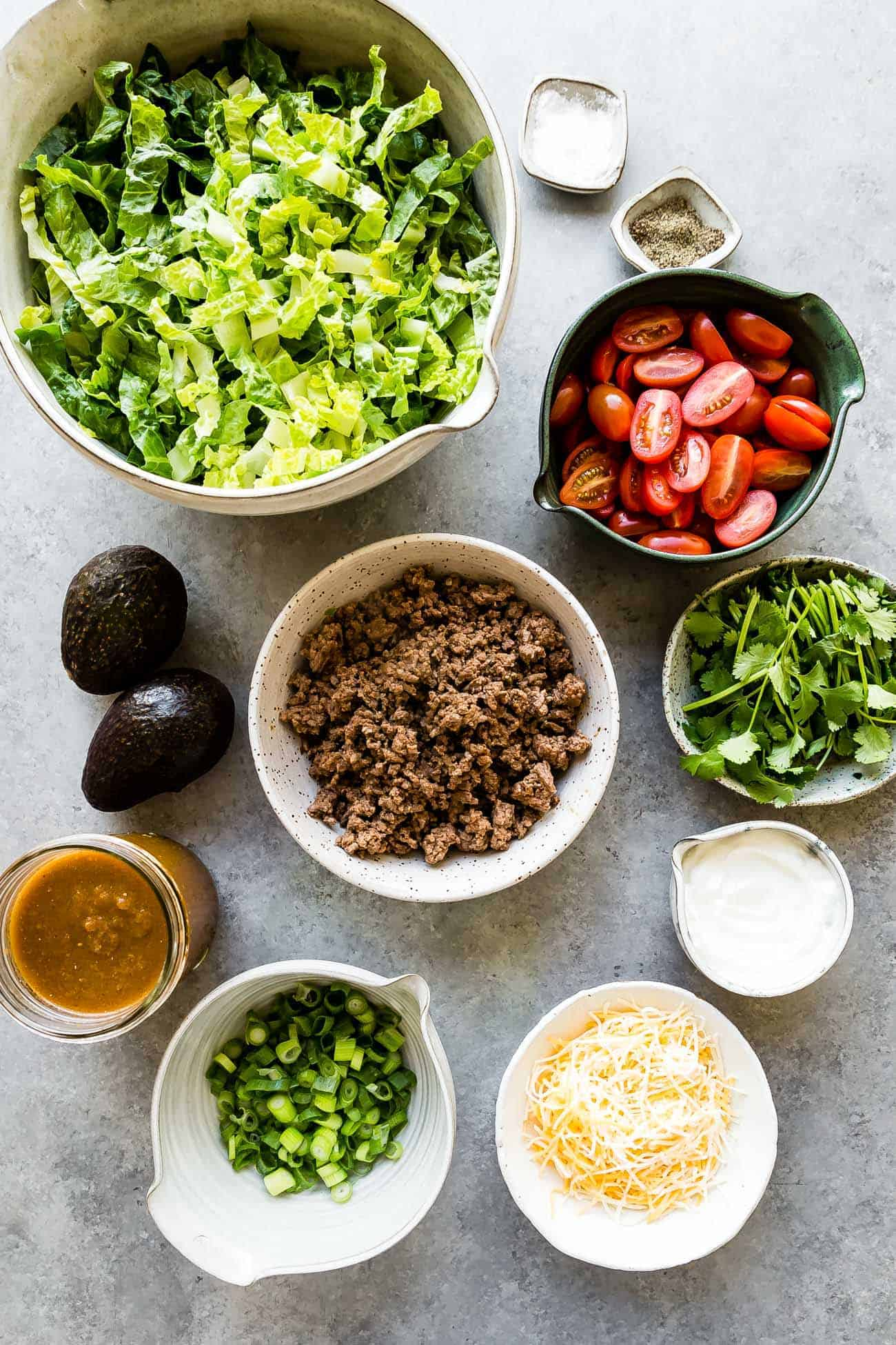 ingredients prepped in bowls to make taco salad