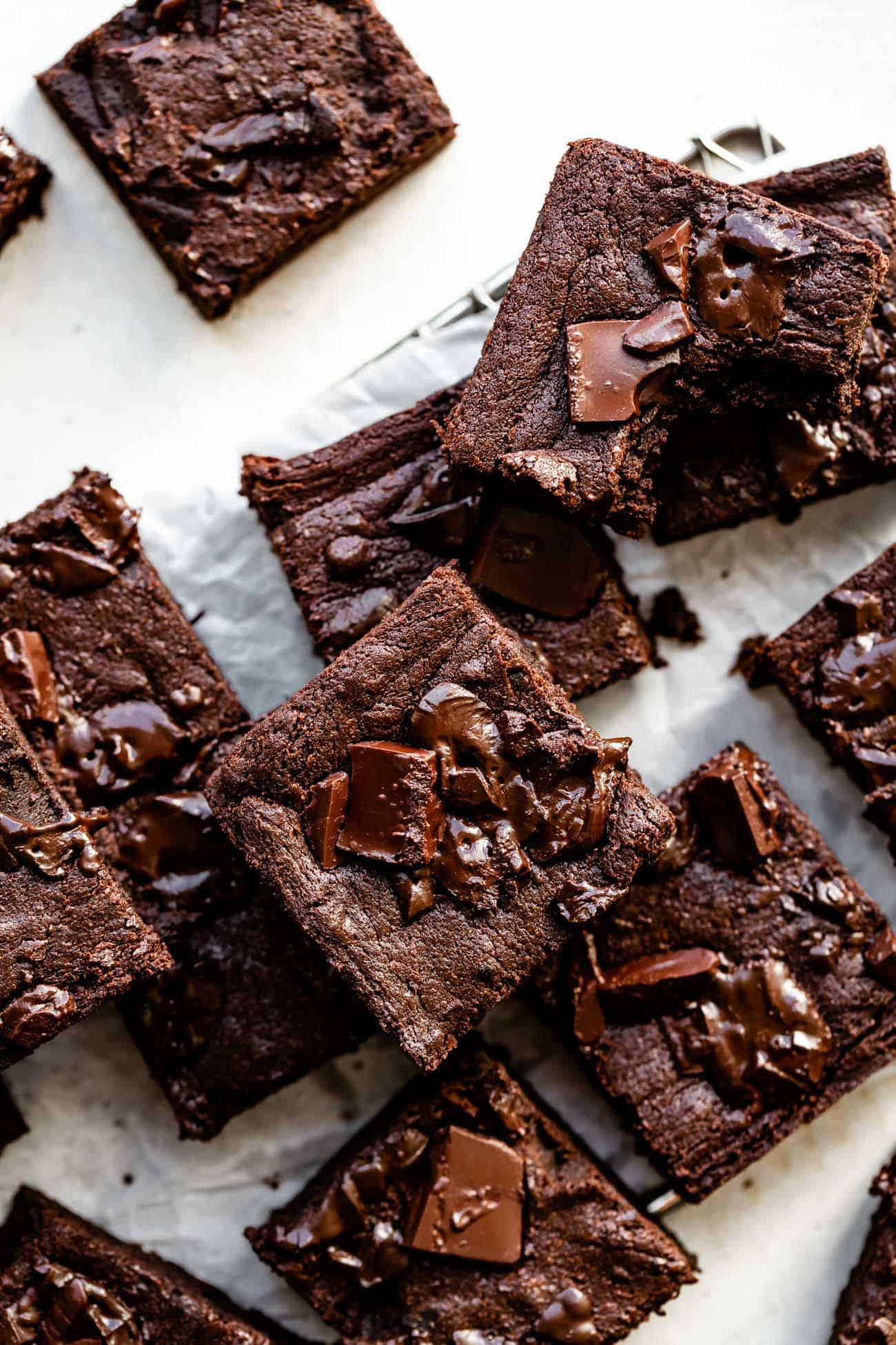stack of pumpkin chocolate brownies on parchment paper